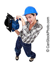 A female manual worker with a circular saw.