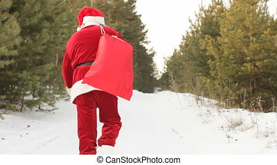 Carrying sack of presents - Santa with sack full of presents...