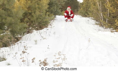 Santa on sled - Santa coming down the hill on sled and...