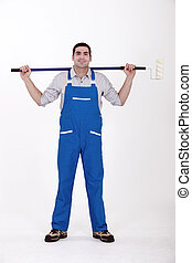 Man stood with extended paint roller