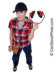 Blond woman holding hearing protection