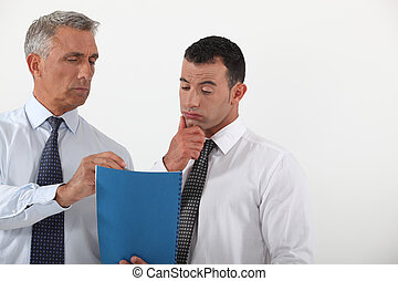 Businessman discussing a document