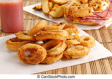 Battered onion rings - Fresh onion rings with a roast beef...