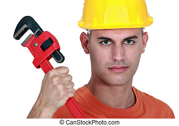 Tradesman holding a pipe wrench