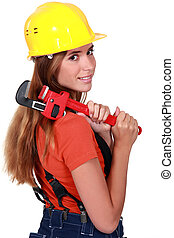 Woman brushing her hair with a pipe wrench