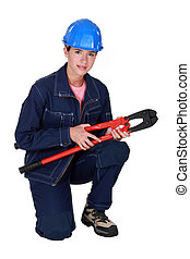 Tradeswoman holding large clippers