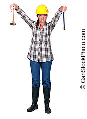 A female carpenter repulsed by her tools.