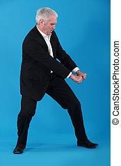 Businessman performing pull gesture