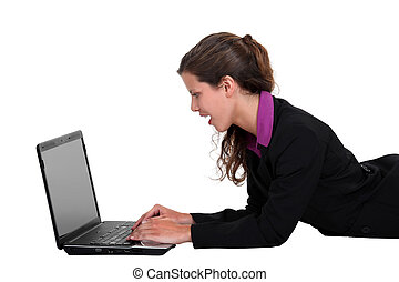 Businesswoman laying down with laptop