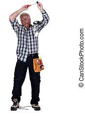 Electrocuted man fixing a light fixture