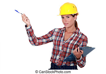 Female builder with a clipboard