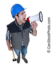 Angry tradesman yelling into a megaphone