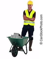A mason with a crazy face and a wheelbarrow