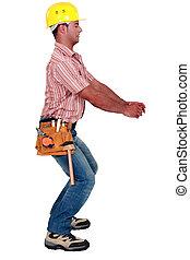 Manual worker pretending to twist object