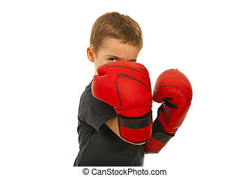 Defending little boy with boxing gloves isolated on white...