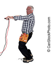Electrocuted man holding jumper cables