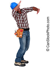 Tradesman using his arms to block a blow