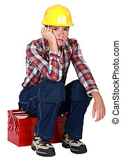A depressed female construction worker.