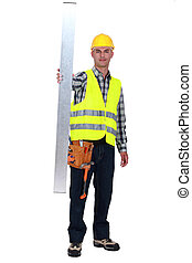 Tradesman holding up a steel girder