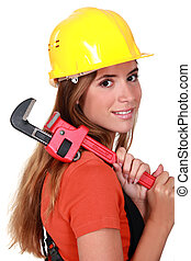 beautiful craftswoman holding a spanner