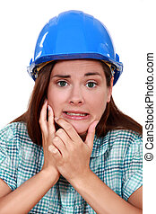 Indecisive woman in a hardhat