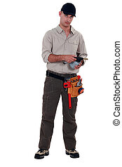 Plumber with blowtorch, studio shot