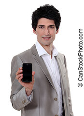 handsome young entrepreneur showing mobile phone