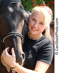 Blond Female Model with Dark Horse under Rowan Tree
