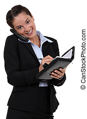 Secretary scheduling an appointment