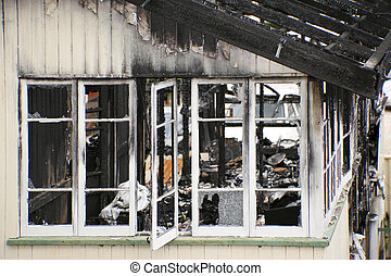 Fire Damaged - Abandoned and fire damaged house