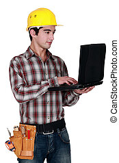 craftsman holding a laptop