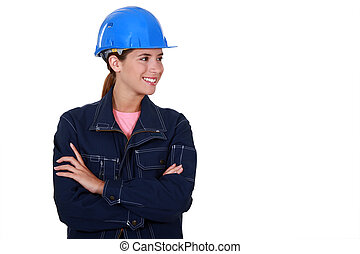 Female builder stood with folded arms