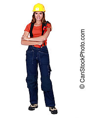 Happy tradeswoman holding a pipe wrench