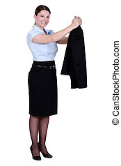 A businesswoman taking off her jacket.