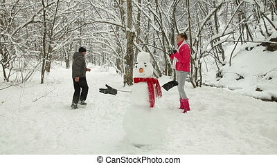 Couple Playing Snowballs - Young Couple Throwing Snowballs...