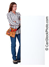 Angry woman standing behind a wall