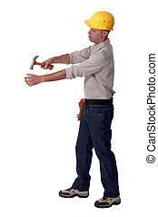 Builder hammering blank space