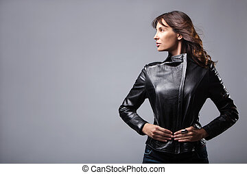 woman in leather jacket