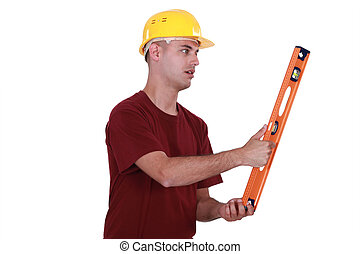 Man holding spirit level