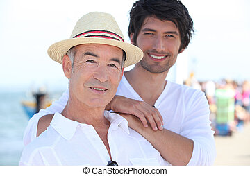 Father and son stood on pier