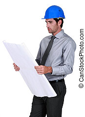 An architect checking his plans.