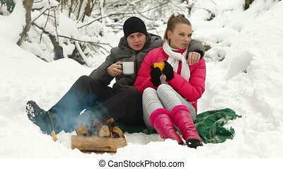 Couple Basking By The Fire - Young Couple By The Bonfire...