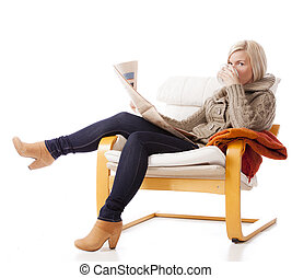 Coffee Break - young, casual woman sitting in an armchair...