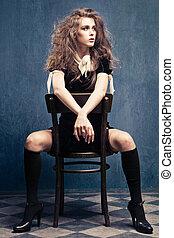 sensual woman - sensual young woman in black dress, leggings...
