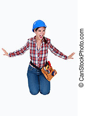 An angry female construction worker.