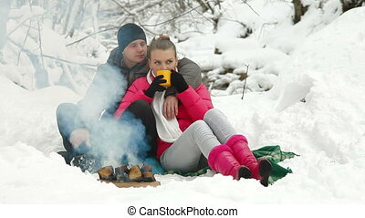 Couple Near Campfire In The Winter