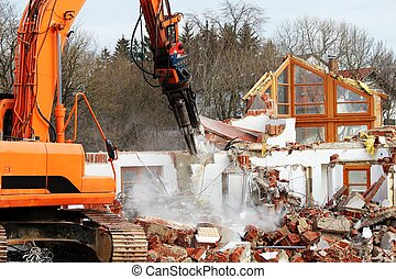 Demolition work on a house with an excavator