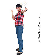 Rejoicing woman holding a paint roller