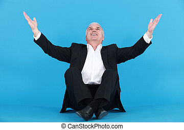 happy businessman thanking God