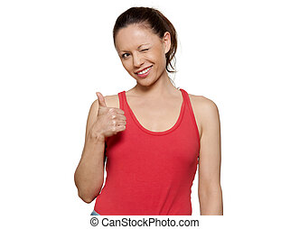 Portrait of cute woman winking and gesturing thumbs up